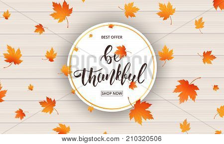Thanksgiving. Be Thankful calligraphy and falling autumn leaves on wooden background. Thanksgiving Day banner.