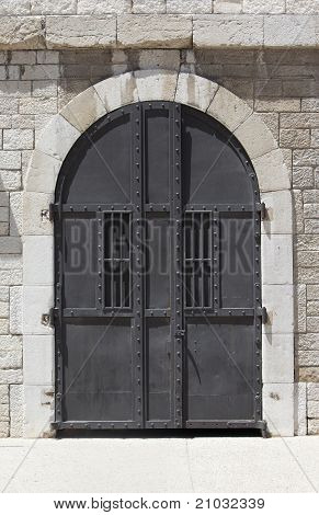 Large Metallic Door And Stone Wall