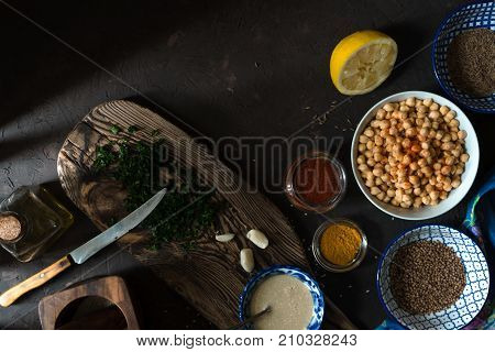 Ingredients for cooking falafel, chickpeas, tahini and spices free space horizontal
