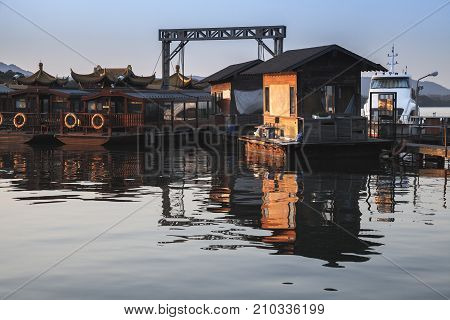 Traditional Chinese Wooden Boats On Lake