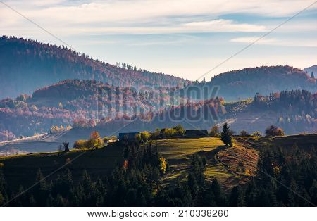Village On Top Of A Grassy Knoll In Autumn