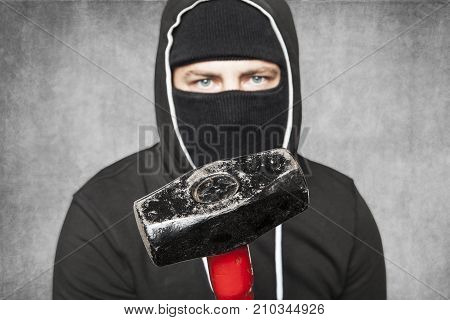 Masked Stranger Shows A Hammer To The Camera