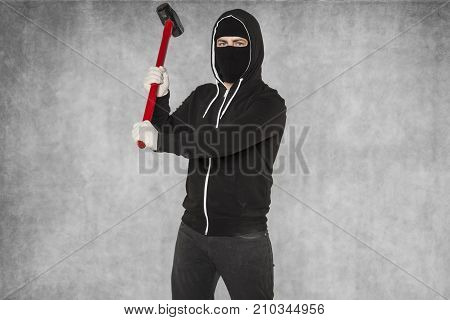 A Masked Stranger Takes An Attack With Large Hammer