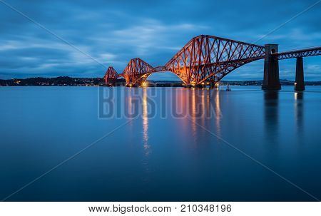 Forth Railway Bridge at Night, which is a cantilever railway bridge across the Firth of Forth in Scotland west of Edinburgh City Centre