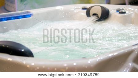 jacuzzi waterfall bath with water, water jet close-up
