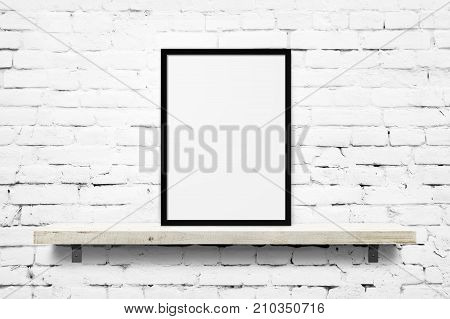 White blank photo frame mockup on shelf over white brick wall background