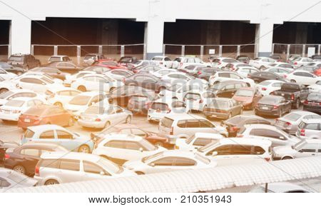 Blurred of Car parking lot at outdoor. Car lot is cleared area that is intended for parking vehicles. Most countries where cars dominant mode of transportation parking lots of every city and suburban.