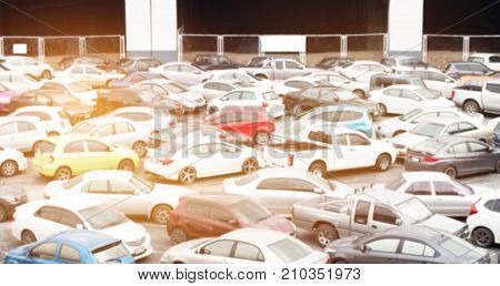 Blurred of Car parking lot at outdoor. Car lot is cleared area that is intended for parking vehicles. Most countries where cars dominant mode of transportationparking lots of every city and suburban.