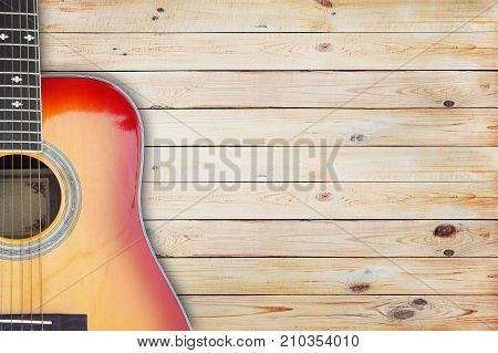 Close up guitar against a rustic wood background