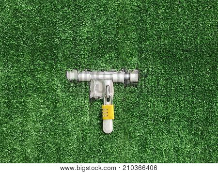 Latch and padlock on artificial green grass wall safety and nature concept