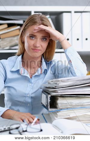 Lot of work wait for tired and exhausted woman. Huge pile of document folders headache and depression irs new problems emotion expression vacancy or holiday dream concept