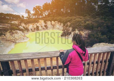 Tourist At Devil's Cave Pool In Rotorua