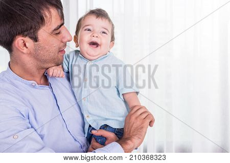 Father Carrying His Son. Good Health Baby Smiling On Shoulder Of Father. Kid And Happy Family Concep