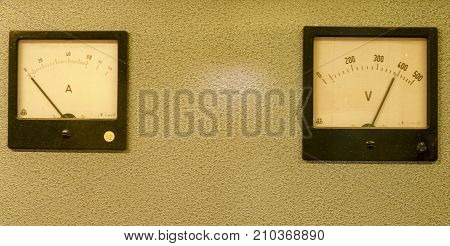 Analog ampere meter or amp meter and analog voltmeter.
