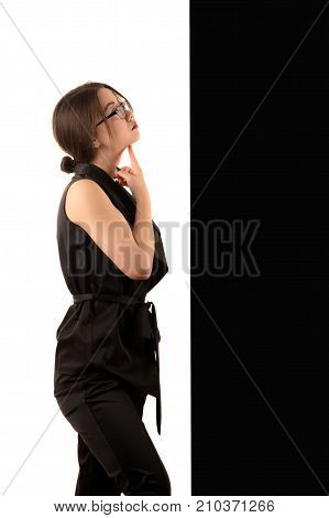 pensive young Korean business woman on black and white background, concept