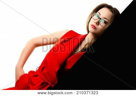 beautiful girl in red suit on black and white background