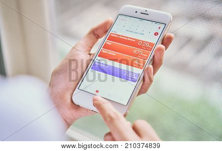 BANGKOK THAILAND - October 24, 2017 : women holding smartphone on the Health app screen on iPhone 6. is an application for iOS 11 which monitor the fitness data of the user.