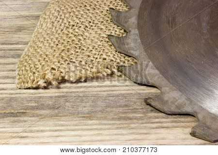 Drive circular saw on wooden table as background