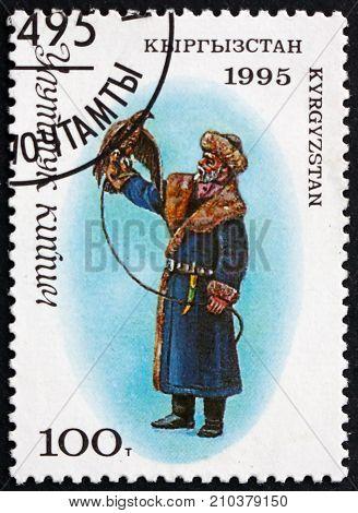 KYRGYZSTAN - CIRCA 1995: a stamp printed in the Kyrgyzstan shows Man in Traditional Kyrgyz Costume with a Falcon circa 1995