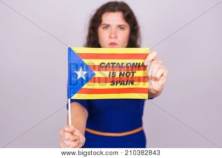 Portrait Of A serious catalan woman with estelada flag. Referendum For The Separation Of Catalonia From Spain. Democracy Independence Concept poster