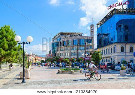 SHKODER ALBANIA - SEPTEMBER 6 2017: Unknown people ride bicycles and walk along pedestrian street (Rruga Kole Idromeno) Shkoder Albania