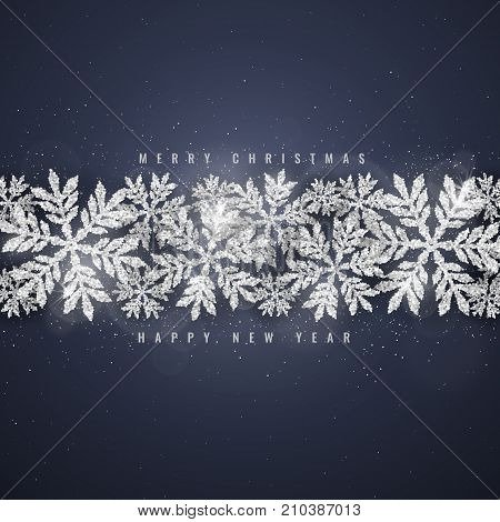 Christmas and new years dark blue background with christmas silver glittering snowflakes on dark background. Merry Christmas greeting card