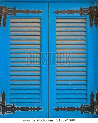 Blue old double-wing sun blind in a vertical format