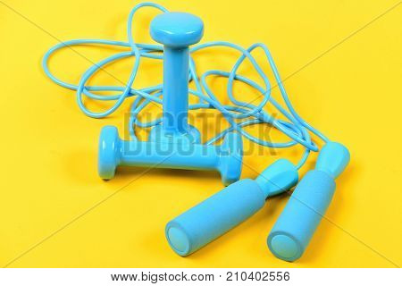Dumbbells And Jump Rope In Cyan Blue Color On Yellow