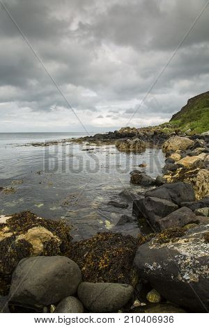 North Antrim Coastline in North Ireland with moody sky