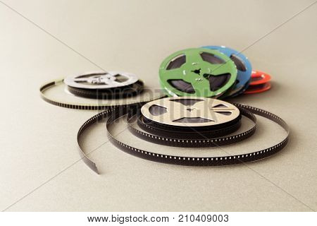 Vintage collection 8 mm cinema film reel. Retro design colorful celluloid accessories for home video projector