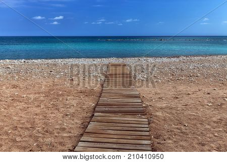 Beach boardwalk A boarded path or wooden boardwalk allowing easy access to and from the sea at Altea in Spain's Costa Blanca