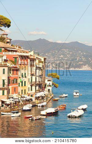 PORTOFINO, ITALY. October 20, 2017: Sea and Coast of Portofino in Italy. Architecture with colorful home. Boats in the small marina.