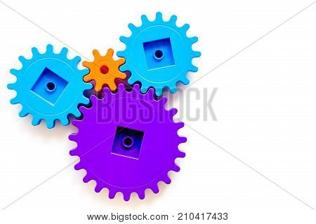 moving forward concept, ideal operating principle with gears and wheels on white desk background top view mock up