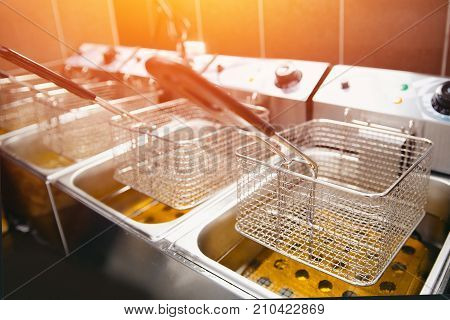 fryer for potatoes with boiling oil. Clean kitchen. Koncept fast food restaurant, equipment