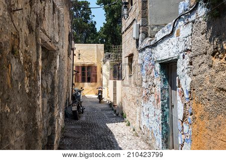 Old narrow street of Rhodes town on Rhodes island, Greece