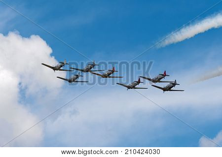EDEN PRAIRIE MN - JULY 16 2016: AT6 Texan planes fly away at air show. The AT6 Texan was primarily used as trainer aircraft during and after World War II.
