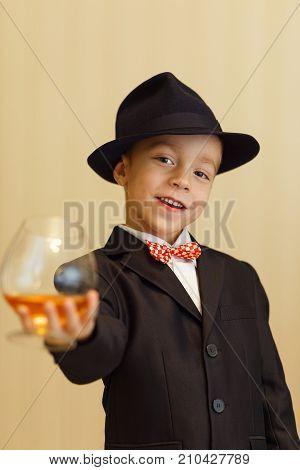The Little Boy Portrays An Adult Gentleman