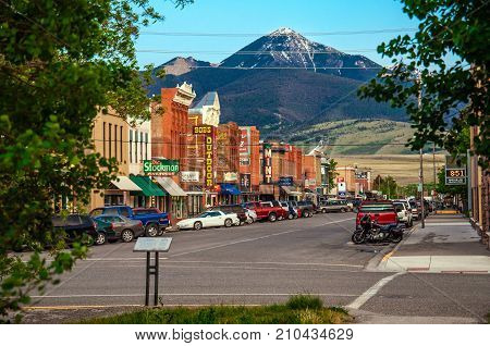 LIVINGSTON, MONTANA, USA - MAY 25, 2013 : Historic centre of Livingston near Yellowstone National Park. Even in the summer time there is snow at the hill behind the city.