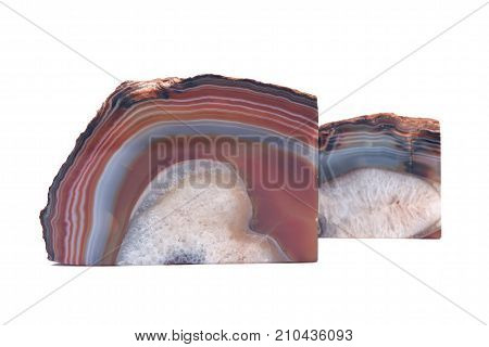 Pair of polished multicolor agate geode bookends isolated on white background