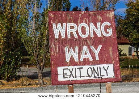 Weathered Wooden Wrong Way Exist Only Sign
