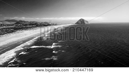 Aerial shot of Morro Rock in Morro Bay California in black and white.