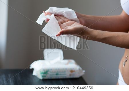 Womans Hands Cleaning With Wet Wipes