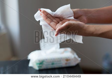 Female Hands Cleaning With Wet Wipes