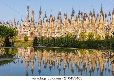 Kakku pagodas reflecting in water.  Nearly 2500 beautiful stone stupas are hidden in a remote area of Myanmar not very far from the lake Inle. Shan state, Myanmar