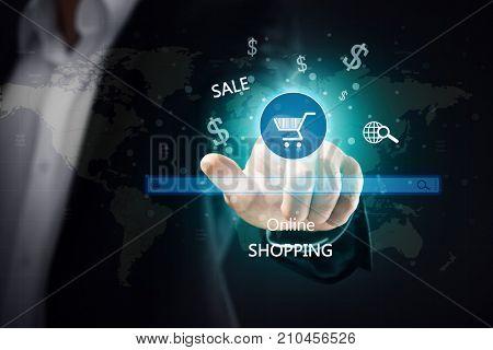 Man pushing shopping cart button of internet store on virtual screen