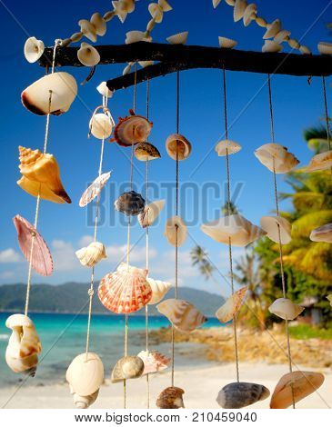 Sea shell chime overlooking a tropical lagoon.