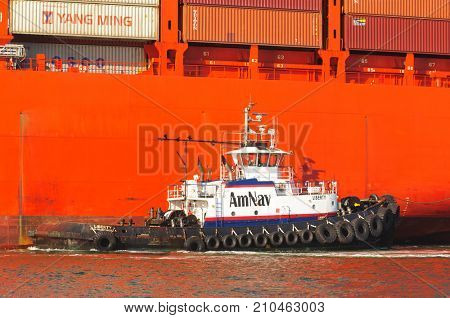 Alameda, CA - March 9, 2015: Oakland Oakland Container Shipyard, San Francisco Bay, the AmNAv tug