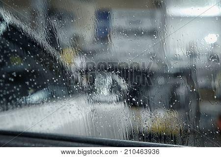 Water drops on tinted car window, closeup