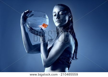 Beautiful young woman with amazing bodyart as Pisces on color background. Zodiac signs concept