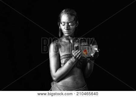 Beautiful young woman with amazing bodyart as Pisces on dark background. Zodiac signs concept